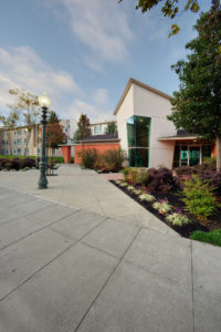 exterior of front entrance, angular building, sidewalk