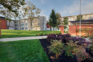 exterior building, grass, sidewalk, plants
