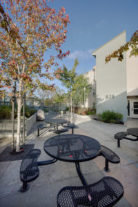 828 building, rest area, picnic tables, trees