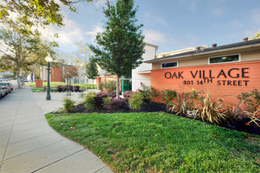 Oak Village sign 801 14th Street, sidewalk