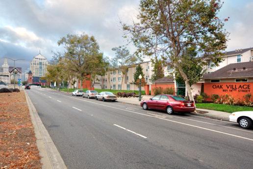 Street facing Oak Village lobby, cars parked